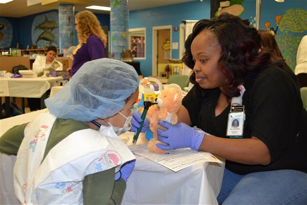 Students learn about hospital and hospital careers at the make-shift Teddy Bear Hospital at BES.