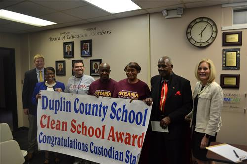Employees receiving clean school award