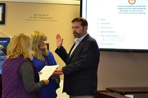David Jones takes his oath of office for the DC Board of Education.