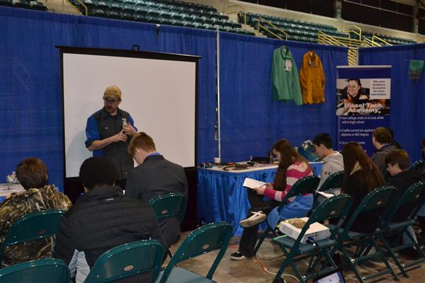 Diesel Mechanic presenter shares knowledge with DCS 8th graders at Career and College Fair