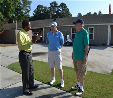 Superintendent Dr. Austin Obasohan talks with EDHS Principal Scott Ballard and his father.