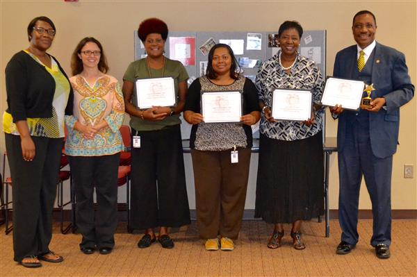 Honorees stand holding certificates at the Duplin County EFNEP Brunch