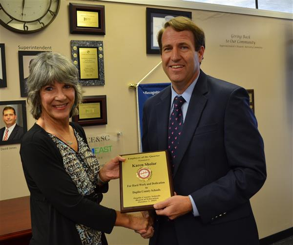 BOE give Ms. Sholar recognition plaque
