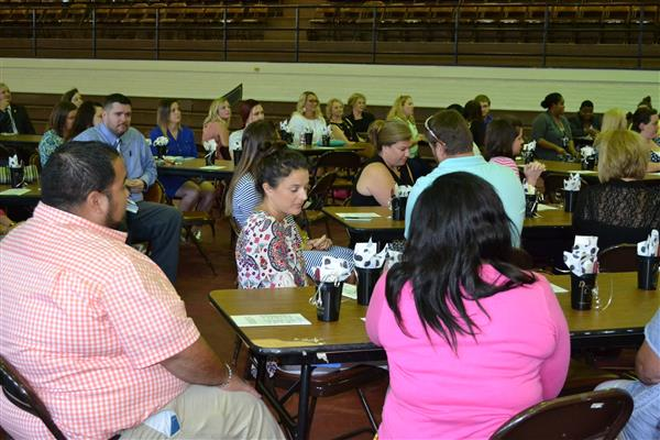 Teachers and administrators seated around tables at the BT 3 Celebration