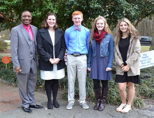 Superintendent Dr. Obasohan stands alongside Duplin Rotary Students of the Month for March