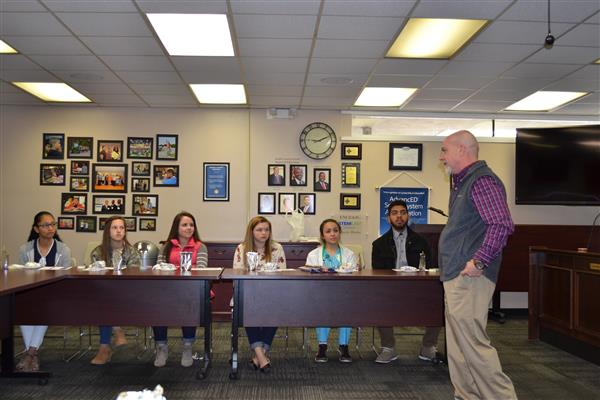 Lt. Scott Kennedy speaks with Superintendent Dr. Austin Obasohan's Student Advisory Committee