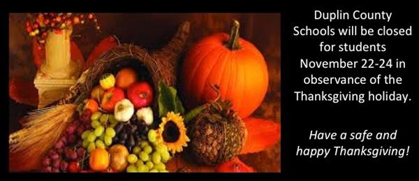 Pumpkins and flowers with message that DCS will be closed for students Nov 22-24