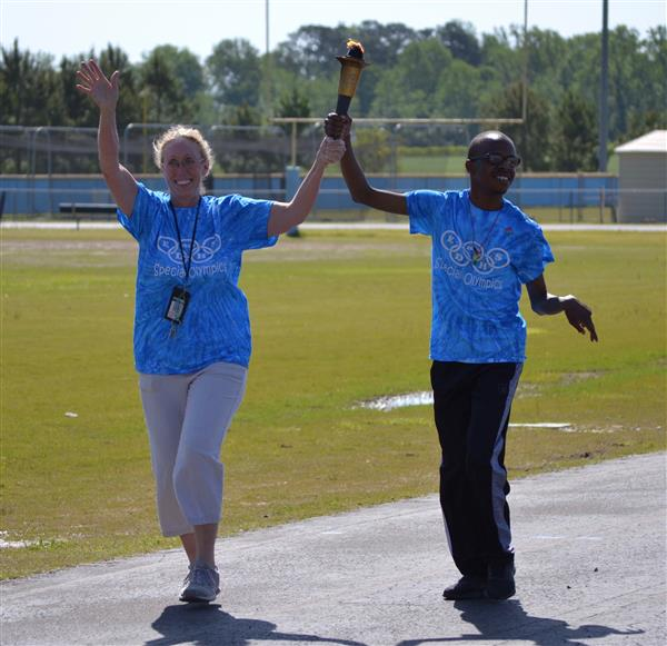 Special Olympian Torch Bearer enters the stadium for the 2018 games!