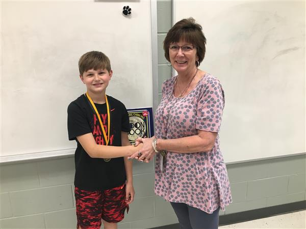 Congratulations to Paxton, the winner of the 4th Grade Spelling Bee!