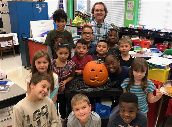 Mr. North's class carves a pumpkin!