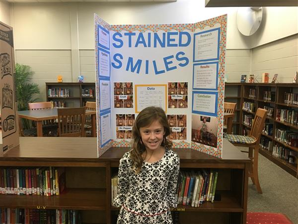 Ava displays her science fair project!