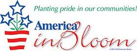 America in Bloom logo with flowers and red white and blue