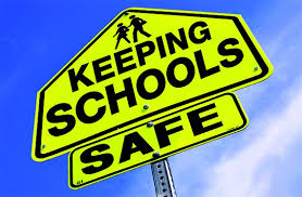 A road sign that says Keeping Schools Safe