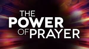 The words The Power of Prayer written in bold white letters against a colorful background